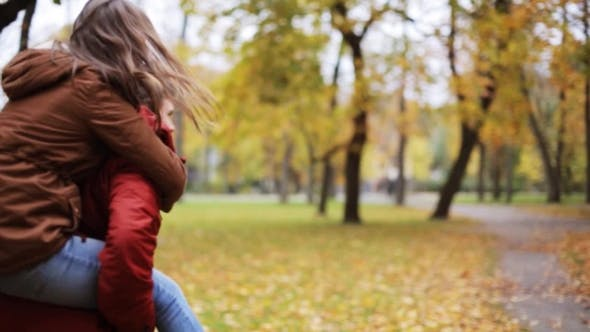 Thumbnail for Happy Young Couple Having Fun In Autumn Park 22