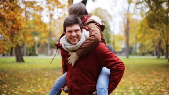Thumbnail for Happy Young Couple Having Fun In Autumn Park 23