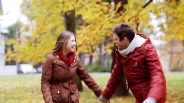 Thumbnail for Happy Young Couple Having Fun In Autumn Park 34