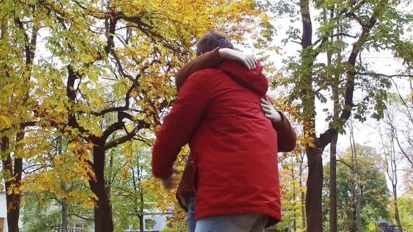 Thumbnail for Happy Young Couple Hugging In Autumn Park 37