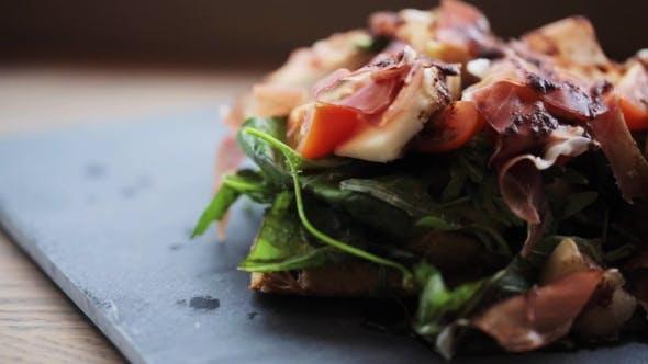 Prosciutto Ham Salad On Stone Plate At Restaurant 34