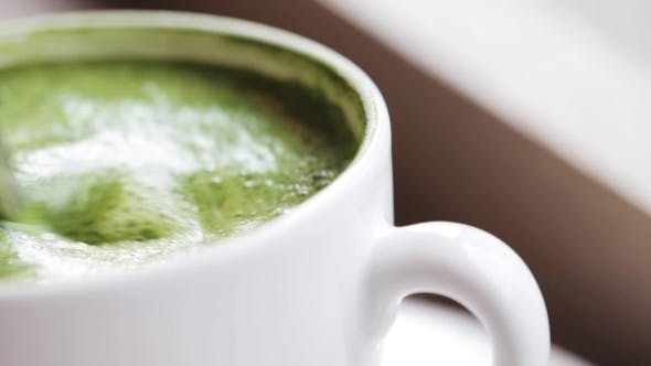Thumbnail for Teaspoon Stirring Matcha Green Tea Latte In Cup 38