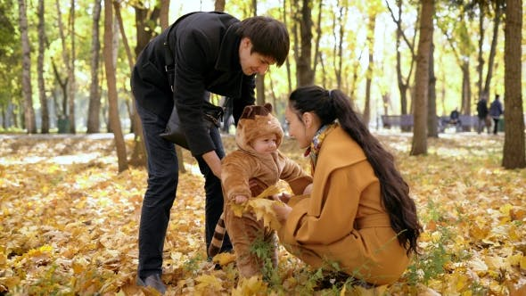Thumbnail for Happy Family At The Time Of The Autumn Holidays In The Woods.