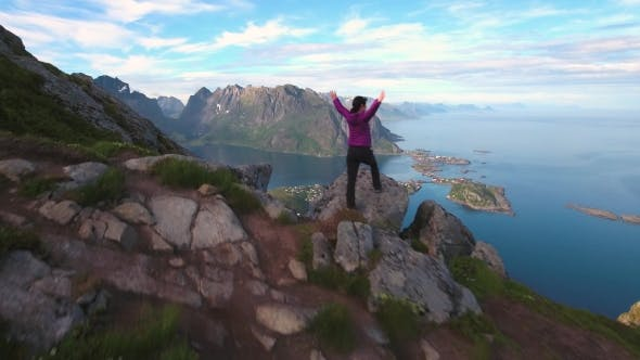 Cover Image for Hiker Woman Standing With Hands Up Achieving The Top