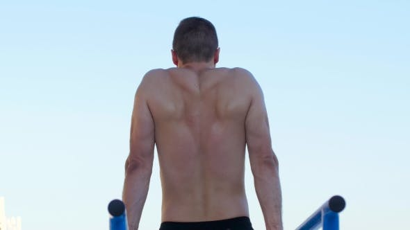 Thumbnail for Athletic Man Doing Push-ups On The Bars