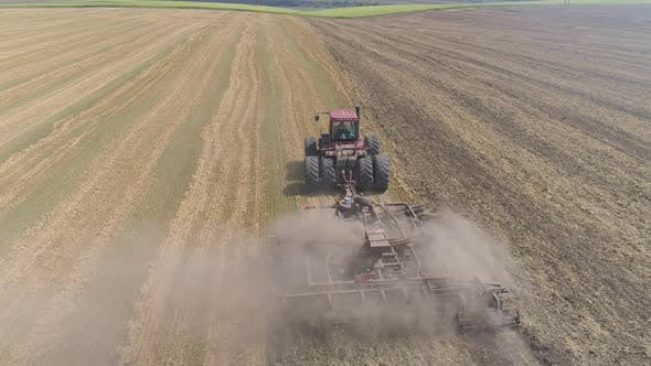 Thumbnail for Aerial view of a tractor plowing in the fields