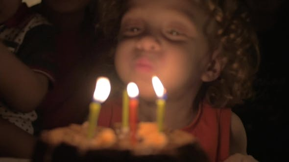 Thumbnail for Child Blowing Candles On Birthday Cake