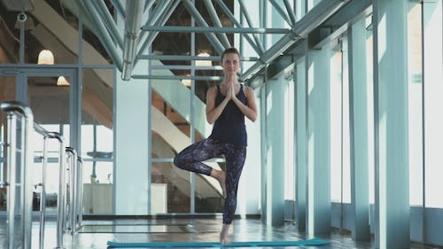 Girl Join Palms In Front Of The Chest Level. Tree Pose In Yoga