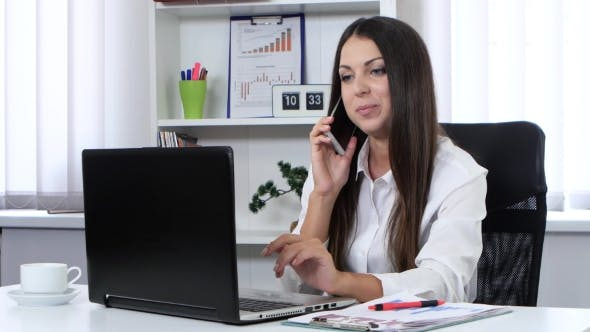 Thumbnail for Girl In The Office Talking On Mobile Phone