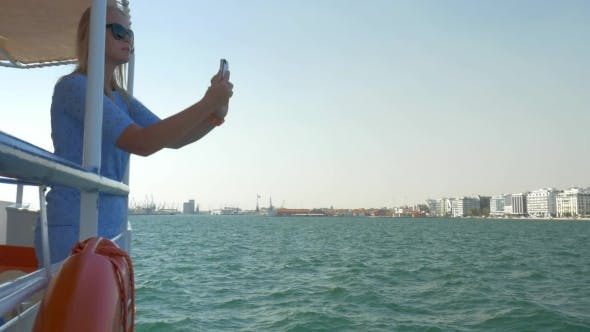 Thumbnail for Girl Travels By Boat In Sea Of City Thessaloniki, Greece And Photographed Seascape