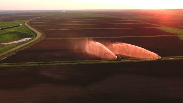Thumbnail for Aerial View, Irrigation System Watering a Farm Field.