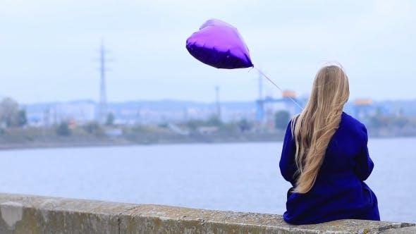 Thumbnail for Sad Girl With Broken Heart Holding Heart Balloon