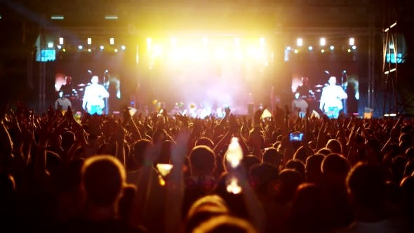Thumbnail for Raised Hands At a Rock Concert Simultaneously Clapping