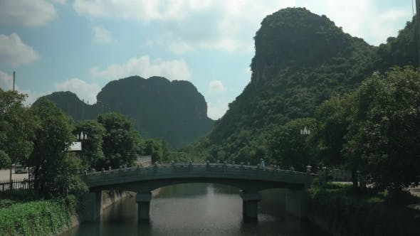 Thumbnail for Man Crossing The Bridge In Trang An, Vietnam