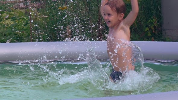 Infant Swimming At The Open Air