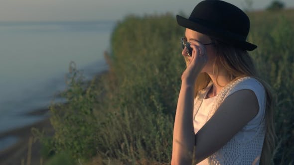 Thumbnail for Young Woman In Sunglasses Sit On The Edge Of a Cliff Enjoying The Nature