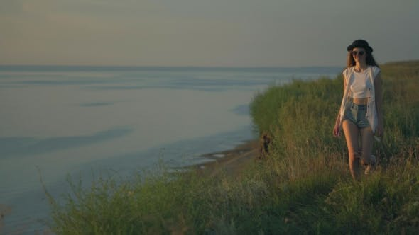 Thumbnail for Young Woman In Walk On The Edge Of a Cliff Enjoying The Nature