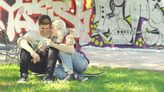 Thumbnail for Young Couple Relaxing In An Urban Park