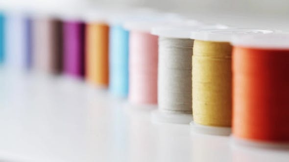 Thumbnail for Row Of Colorful Thread Spools On Table 1