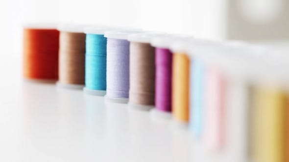 Cover Image for Row Of Colorful Thread Spools On Table 2
