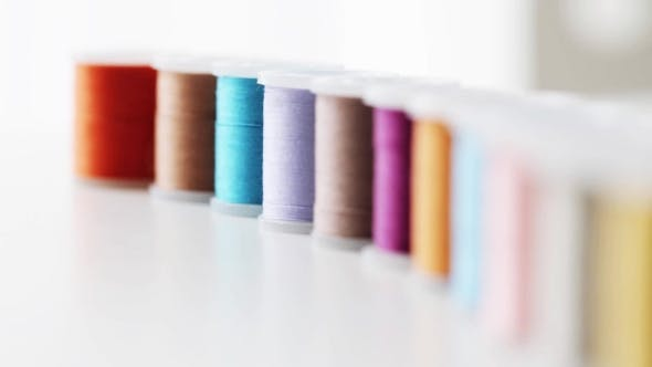 Thumbnail for Row Of Colorful Thread Spools On Table 3