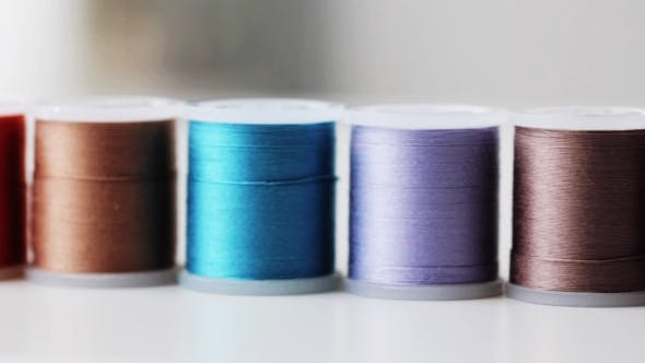 Thumbnail for Row Of Colorful Thread Spools On Table 4