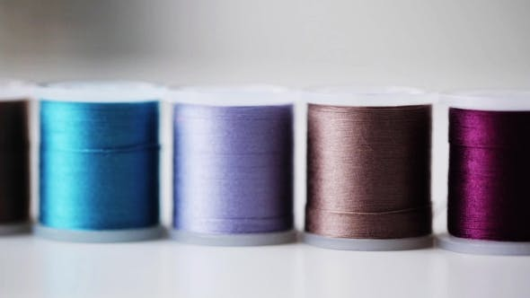 Cover Image for Row Of Colorful Thread Spools On Table 5