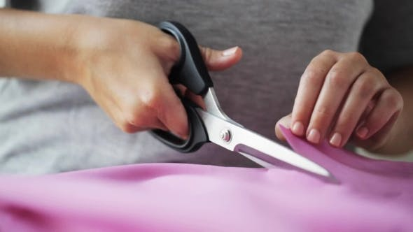 Thumbnail for Woman With Tailor Scissors Cutting Out Fabric 39