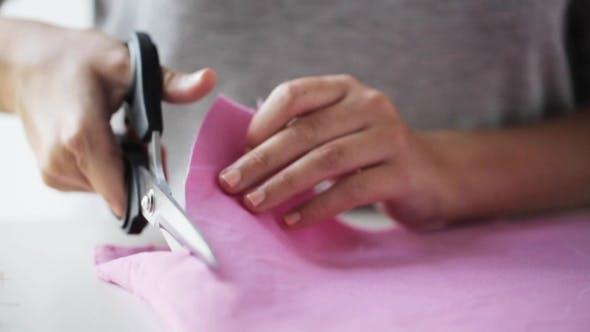 Thumbnail for Woman With Tailor Scissors Cutting Out Fabric 40