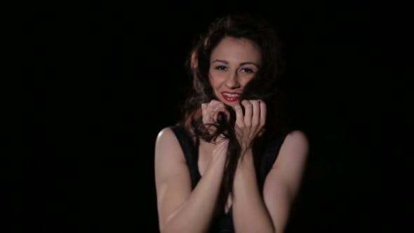 Thumbnail for Young Brunette In Black Party Dress Dancing, Smiling, Having Fun And Flirting