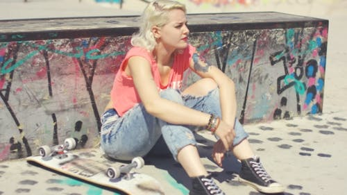 Young Woman Waiting At a Skate Park For a Friend