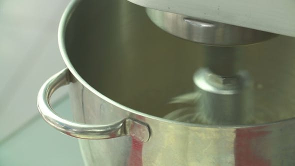Thumbnail for Whipping Cream Or Egg Whites In Metal Bowl With Electric Mixer Machine.