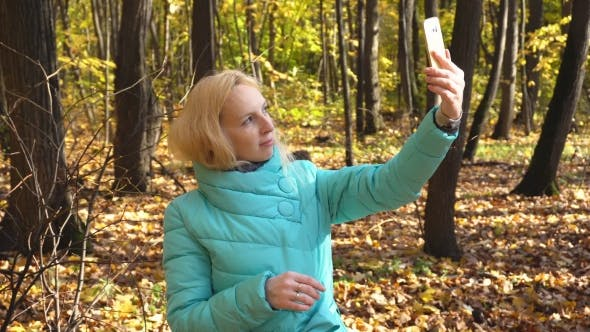 Thumbnail for Beautiful Girl Makes Selfie In The Autumn Forest