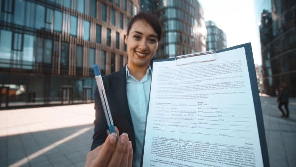 Thumbnail for Young Business Woman With Documents Ask You For Signature