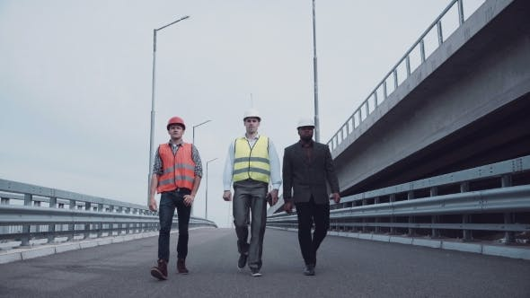 Thumbnail for Construction Engineers Walking On Highway Ramp
