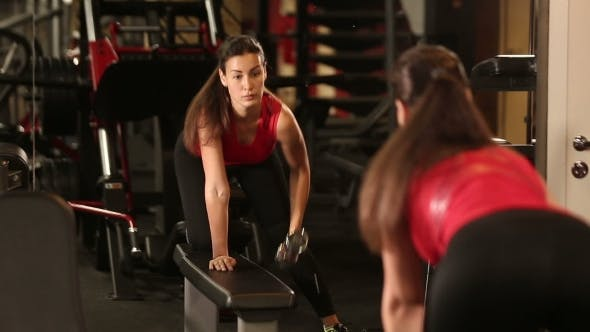Thumbnail for Professional Athletic Woman Pumping Up Muscles With Dumbbells In Gym Interior. Strong Woman Crossfit