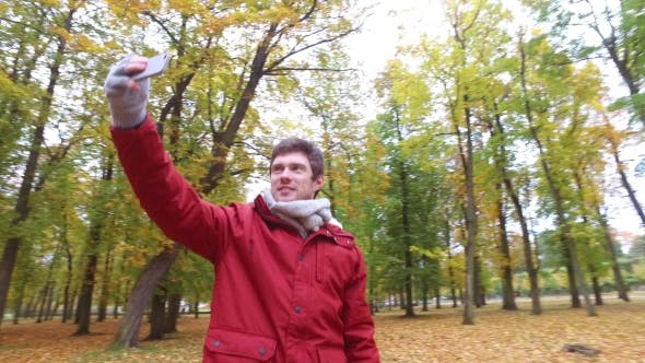 Thumbnail for Man With Smartphone Taking Video At Autumn Park