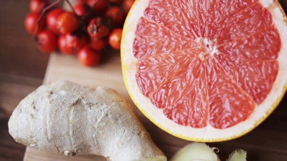 Thumbnail for Ginger, Grapefruit, Orange And Garlic On Board