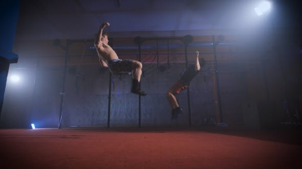 Thumbnail for Two Athletes Doing Difficult Crossfit Exercise At The Same Time.