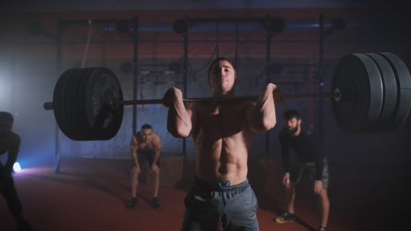Thumbnail for Young Man Doing The Clean And Jerk Weightlifting Exercise At The Gym.