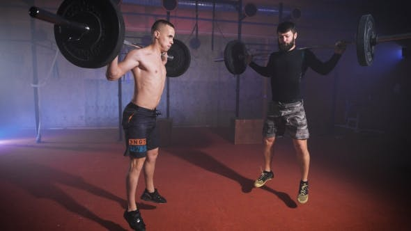 Thumbnail for Two Strong Man Doing Weightlifting Training Together At The Gym.