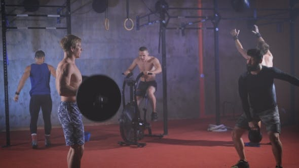 Thumbnail for Five Strong Athletes Doing Group Crossfit Training At The Gym.