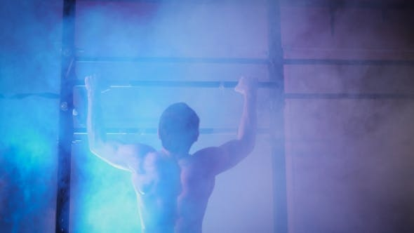 Thumbnail for Young Muscular Athlete Doing Pull-up Exercises.