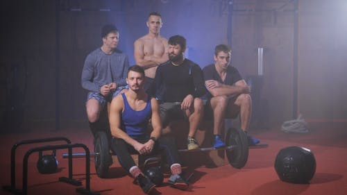 Group Of Strong Men At The Gym Shaking Their Heads To Indicate Rejection.