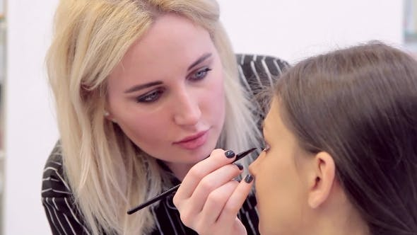 Thumbnail for Blonde Make-up Woman With Eye-liner Applys Make-up