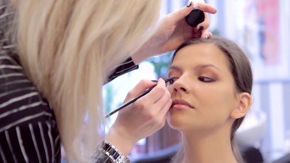 Thumbnail for Applying a Eye-liner In Make-up On Modal's Face