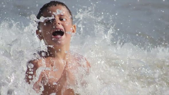 Cover Image for Boy Sitting On The Beach And Laugh