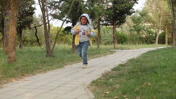 Thumbnail for Boy Is Running On Pathway