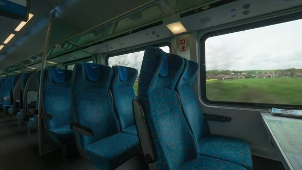 Modern Empty Train Wagon With Table, Seat Places And Windows, Vienna, Austria