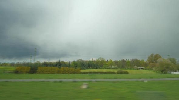 Thumbnail for Shot Of Moving Countryside Landscape From Window Of Train, Vienna, Austria